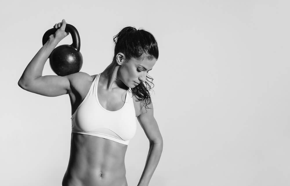 slim girl doing kettlebell