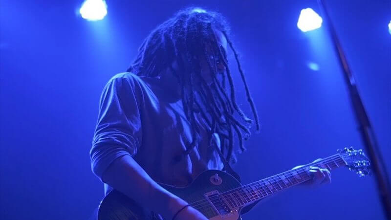 rasta man playing guitar
