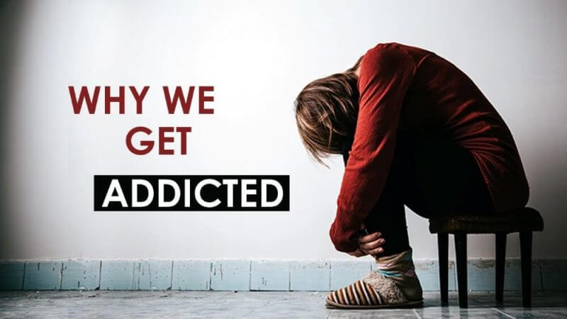 why we get addicted and a man seated with his head down