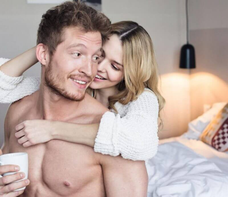 man with a girl in bed