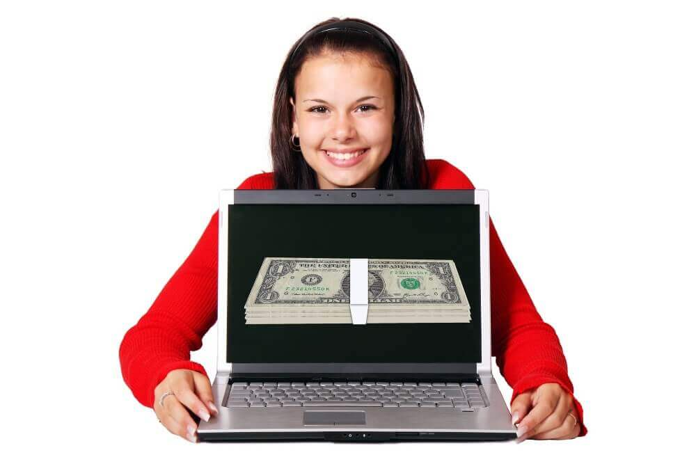 a woman showing her laptop