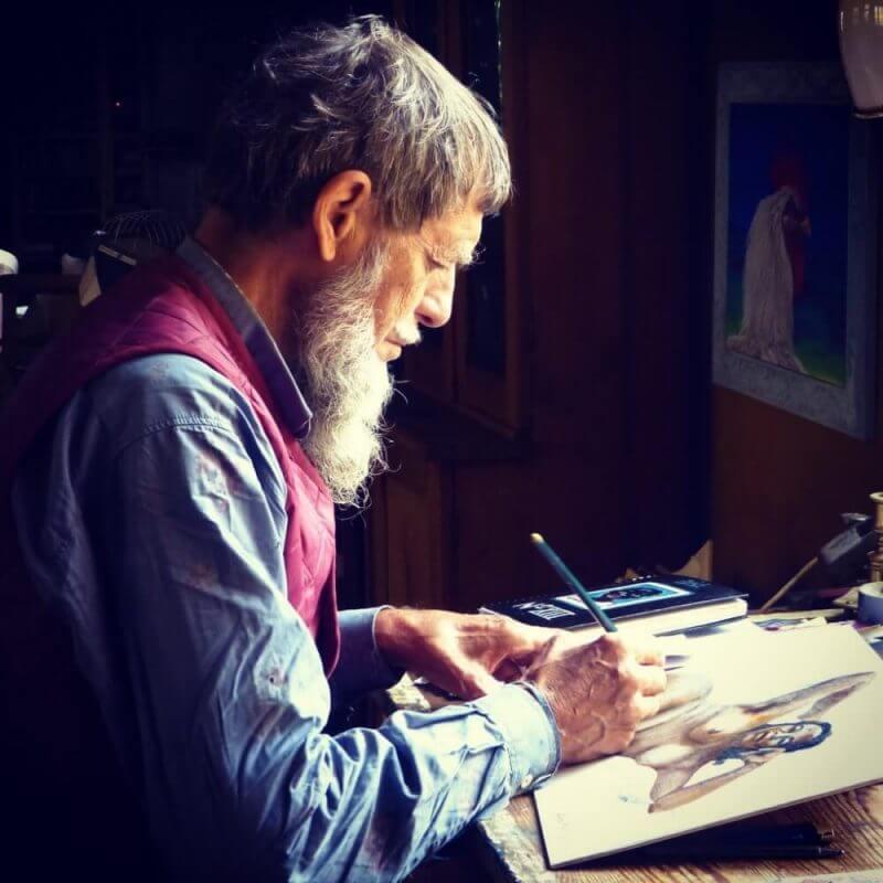 elderly man drawing