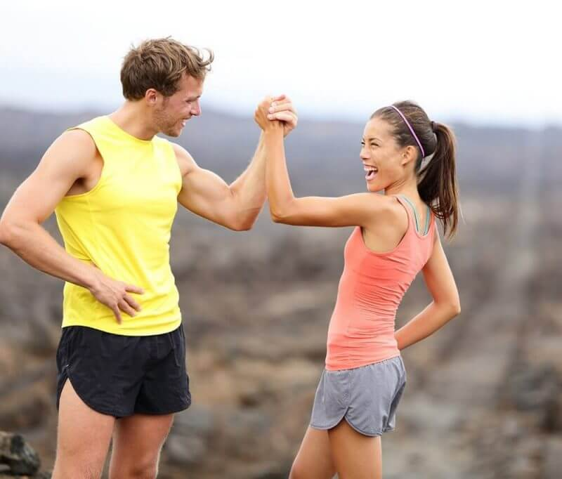 man-woman-high-five-10-daily-habits-blast-belly-fat