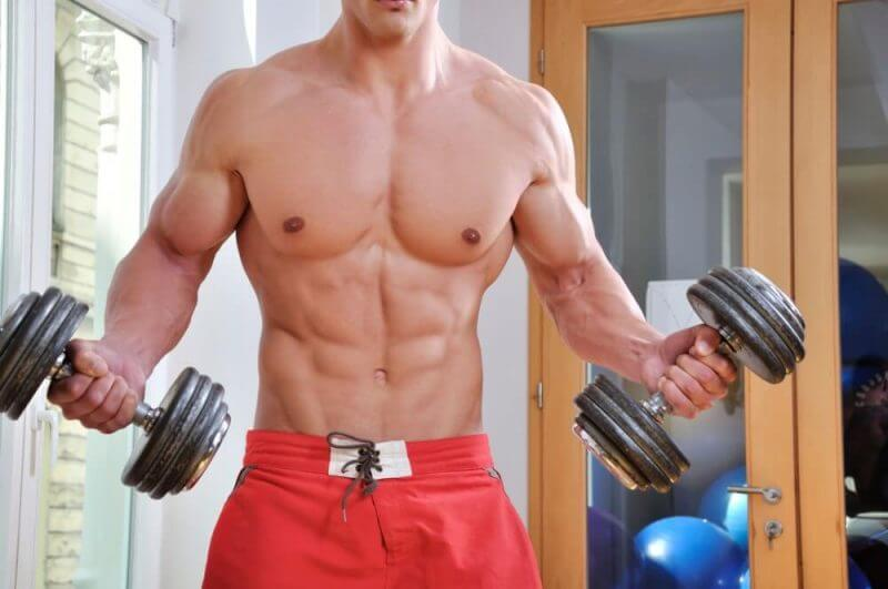 musculine man lifting weights