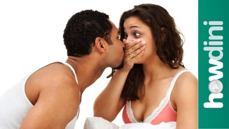 man close to a woman with her mouth closed