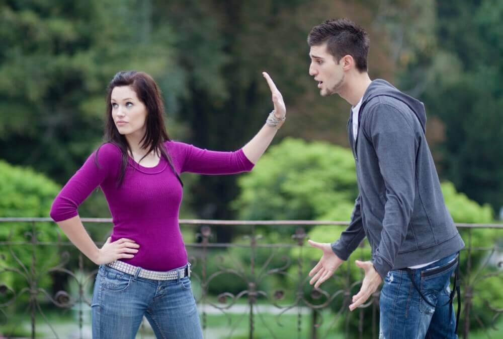 a woman and a man arguing