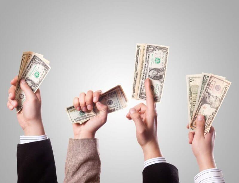hands holding money
