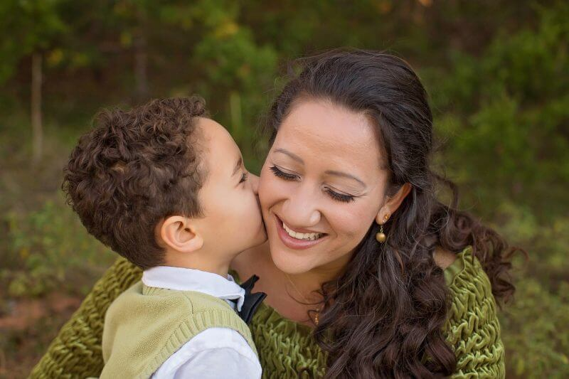 happy mother and boy reading success