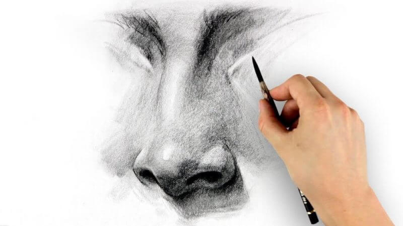 hand and pencil