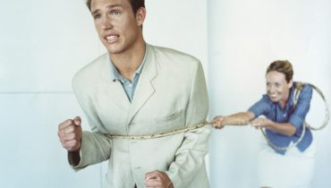 Woman with rope tied around man