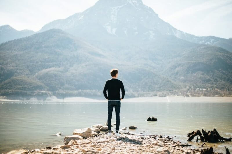 man stairing at the lake water