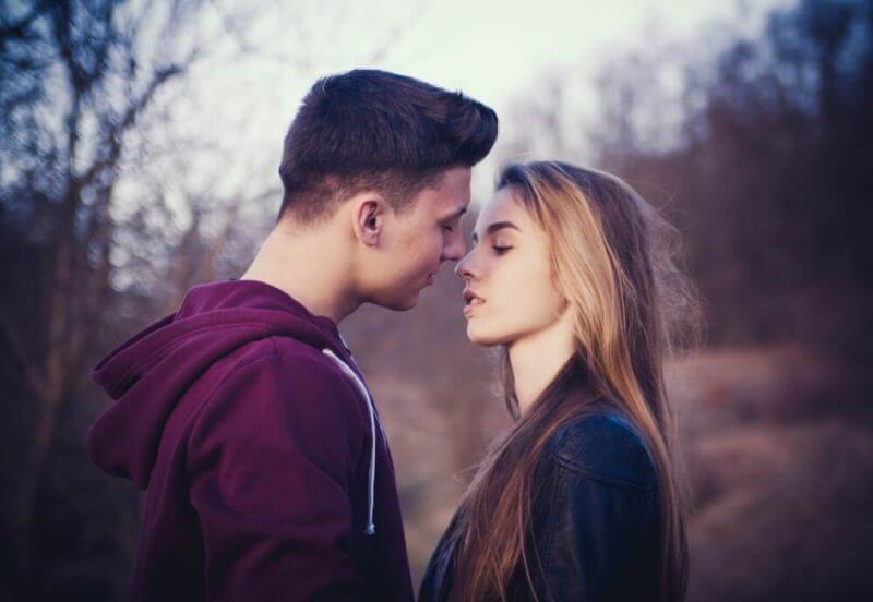man and a girl kissing