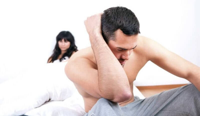 couples in bed worried