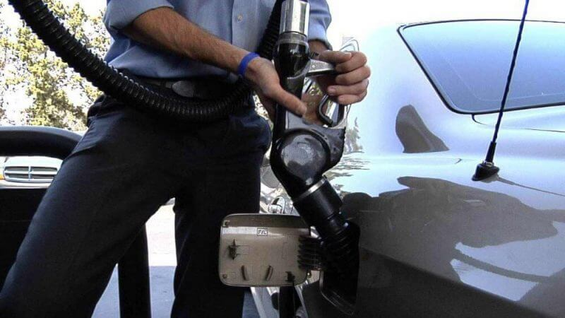 man fueling his car