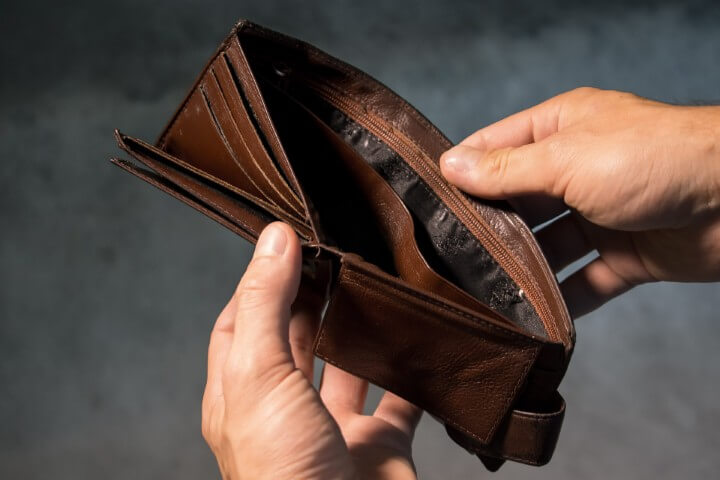 two hands holding open an brown empty man wallet