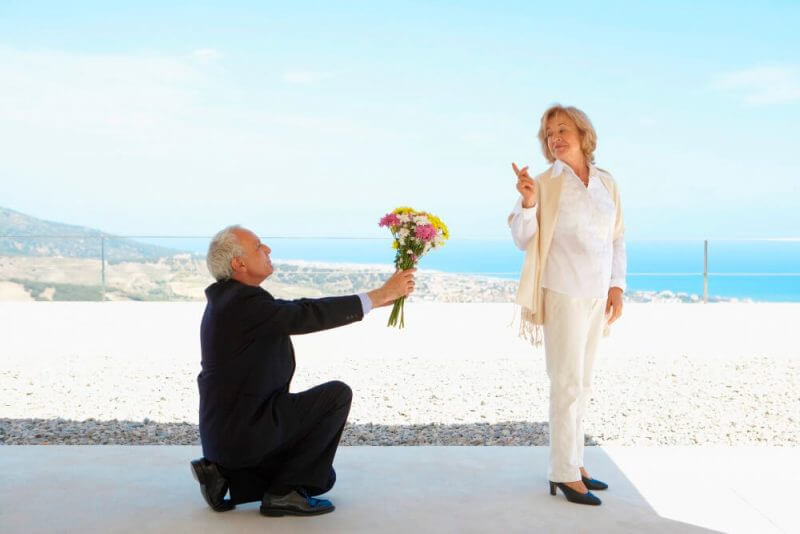 Mature Man on Knees in Front of Woman