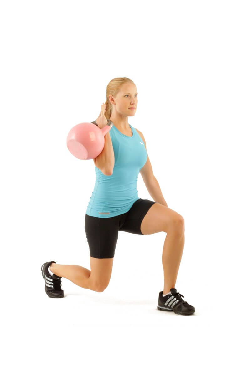 a lady carrying kettlebells