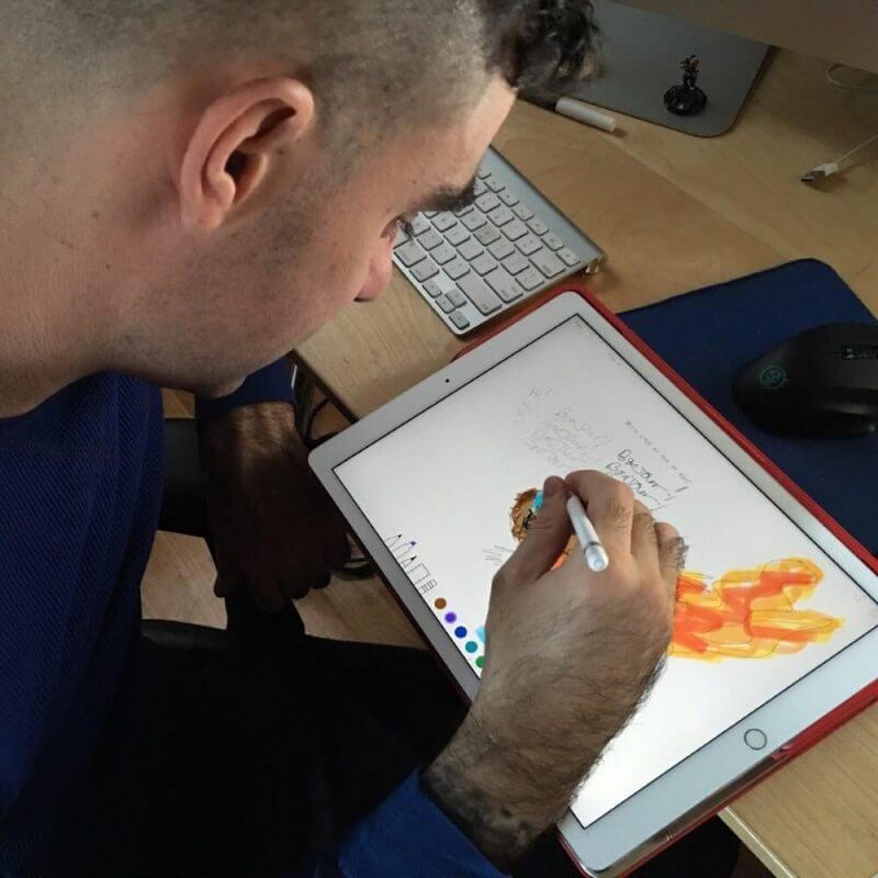man making drawings