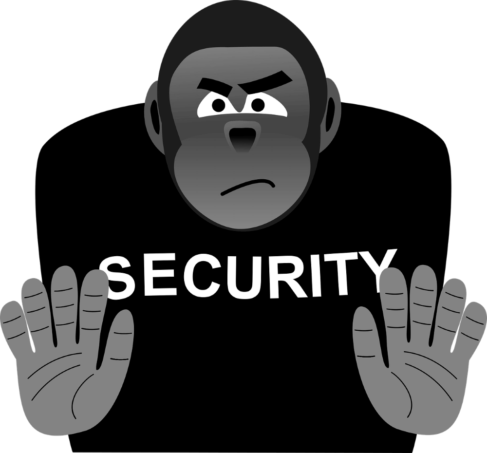 a monkey in a security shirt