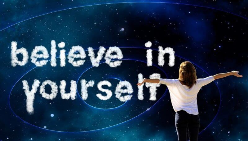 believe in yourself and a lady lifting her hands