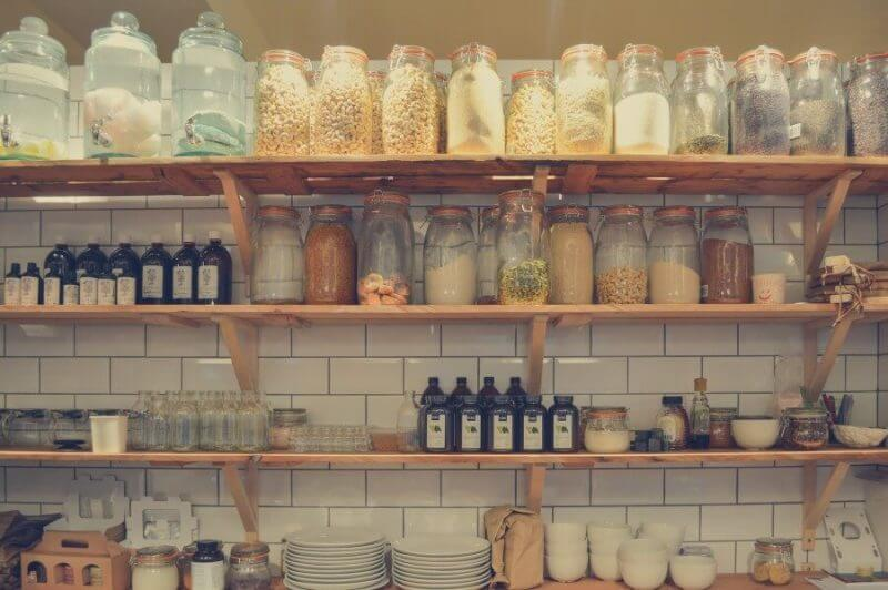 food stored in bottles in shelves