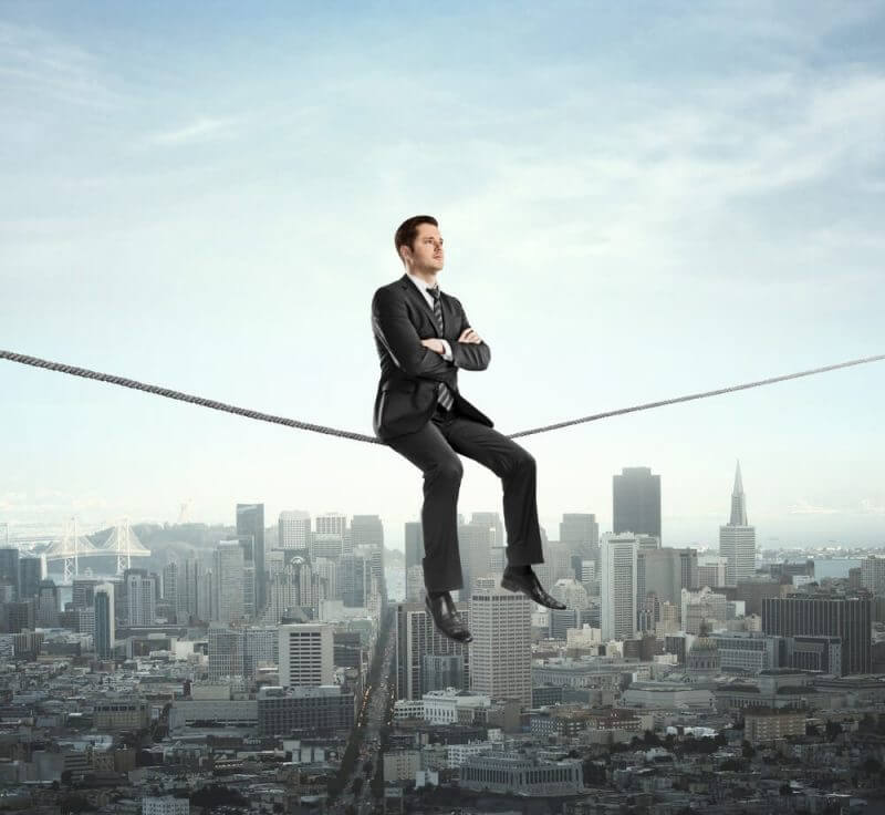 man seated on a rope