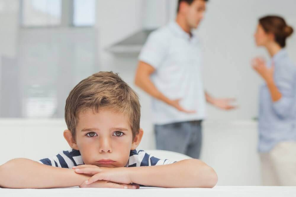 a kid looking depressed and parents fighting in the background