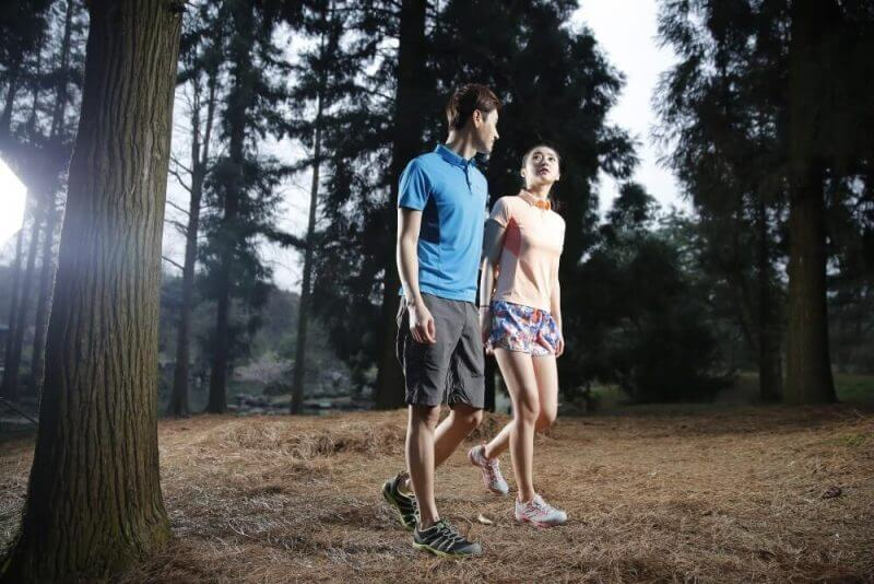 lovers walking in a forest