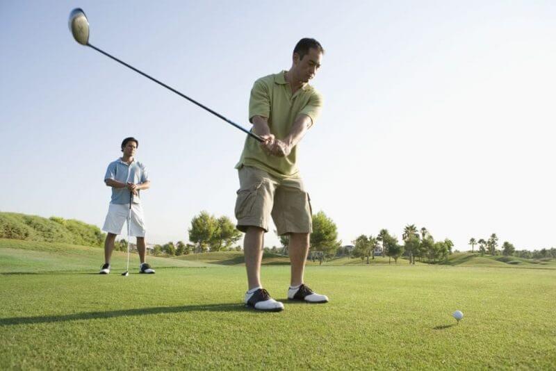 man making a golf swing