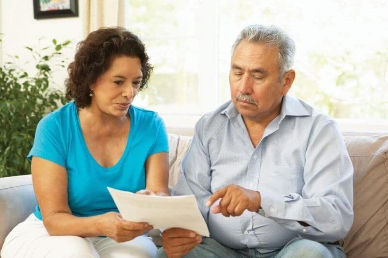 man and woman looking at a report