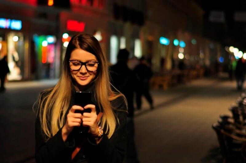 Texting and smiling