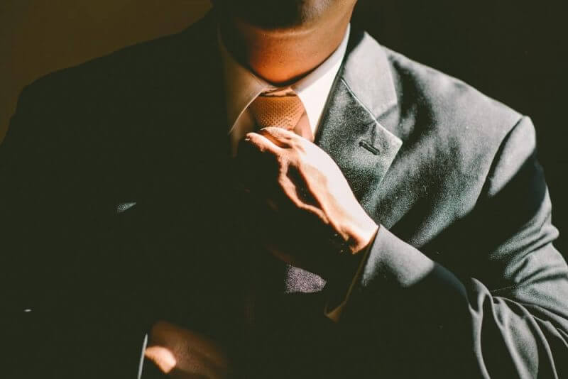 man holding a tie