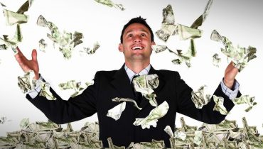 man celebrating money