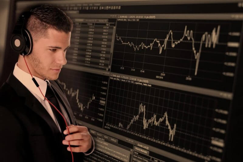 a person observing a forex trading machine