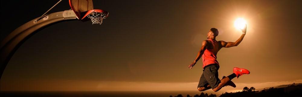 man jumping to a basketball