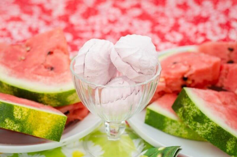 a glass and water melons