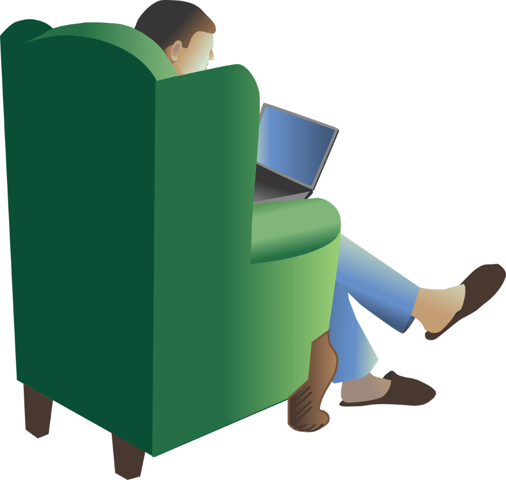 a guy on a sofaset with his laptop