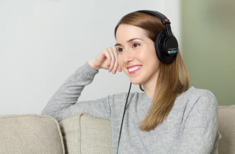woman with headphone smiling