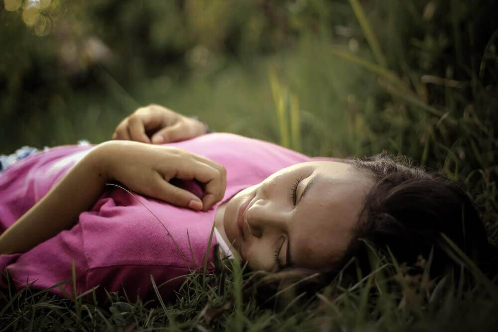 cute lady laid on grass